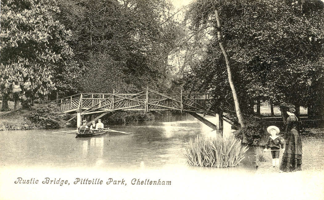 Three men and a rustic bridge (1908)