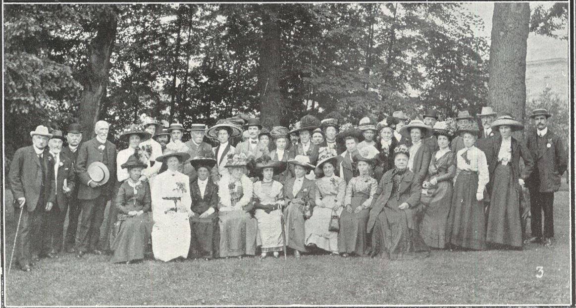 Committee members, stall-holders, and leaders of the Liberal Party<br>'Mrs Parsons, who has left Cheltenham, is seated in the centre, in dark dress'<br>Well, that pins her down, then<br><small><i>Cheltenham Chronicle and Gloucestershire Graphic</i> 22 June 1912</small>